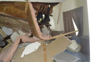 Tree smashes into Ethridge's home on Back Penn Road.