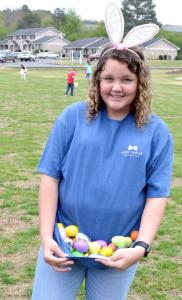 Erin Tapp 14 helps hold eggs for youngster